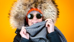 lady wearing a fur hat for photography and video production